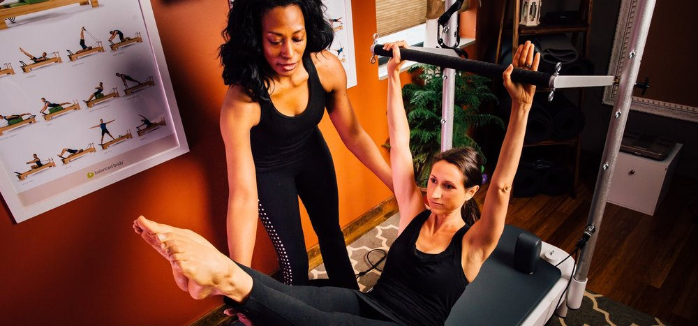 jen-using-the-reformer-at-whole-pilates.jpg