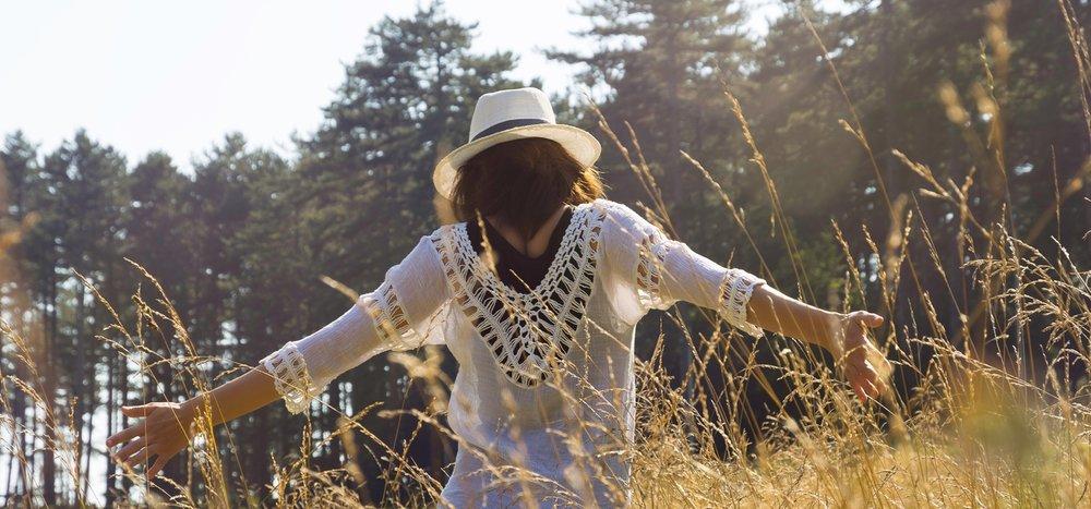 Woman dancing in a field.jpg