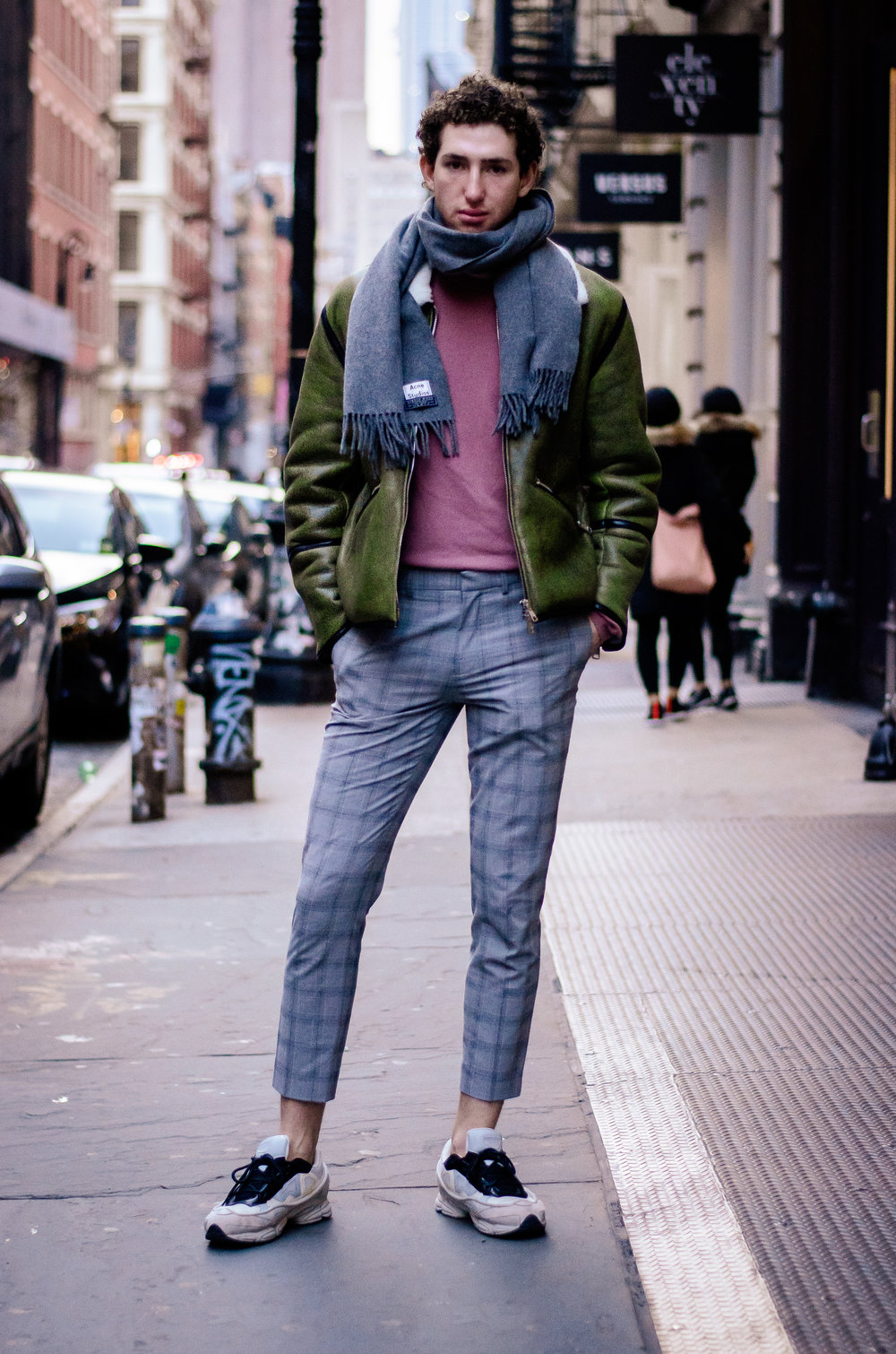 Deep nostalgia for temperate days: His winter outfit features warm-coloured pieces such as his green shearling jacket, and blush-red sweatshirt. Also, given the frigid temperatures, he bravely ditched the socks. The resulting combination of ankle exposure, plaid pants, and Raf Simons sneakers is a style move worth stealing.