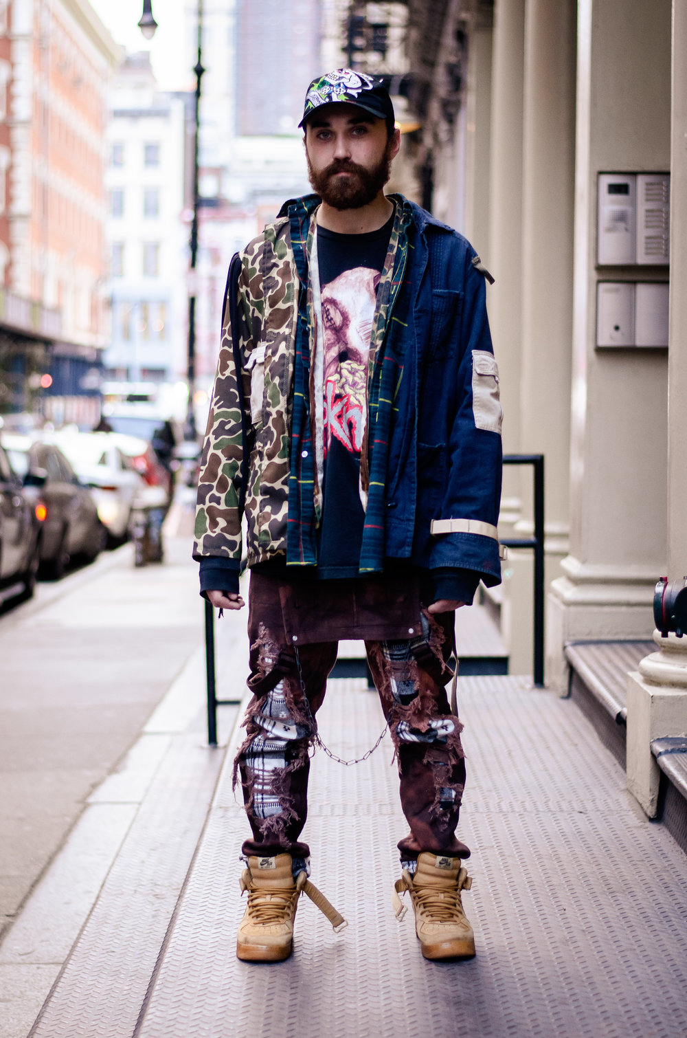 When in doubt, create your own statement pieces, right? Emmett creates his own pieces with clothing found at thrift stores, and flea markets. His jacket is made from camo-print, plaid, and chambray fabrics. Moreover, he dyed and distressed his overalls. The resulting look can be described as experimental grunge