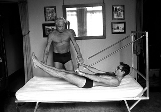 Joe Pilates attached strings to hospital bed so patients could start toning their muscles even while they were still bed-bound.