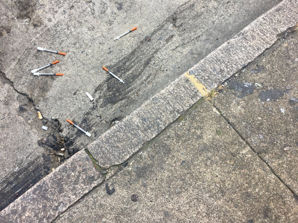 it is not uncommon to see a bouquet of needles on the ground in the tenderloin. this isn't a sign of danger like most people would suspect... this is a sign that someone needs help.