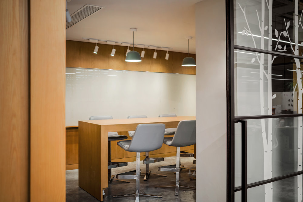 High bench meeting room with visual connectivity to the open office area.