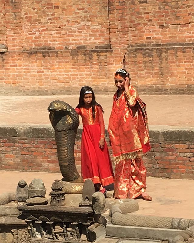"Another Nepali celebration for the coming of ""womanhood""  these beautiful girls at the washing pool in the ancient kings palace in Bhaktaphur, Dhurba Square ... it's surrounded by serpents! . . . #nepal #hindutradition #bhaktaphur"