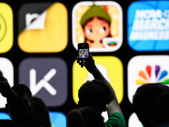 An attendee takes a photograph with an iPhone at Apple's Worldwide Developers Conference on Monday.  DAVID PAUL MORRIS/BLOOMBERG/GETTY IMAGES