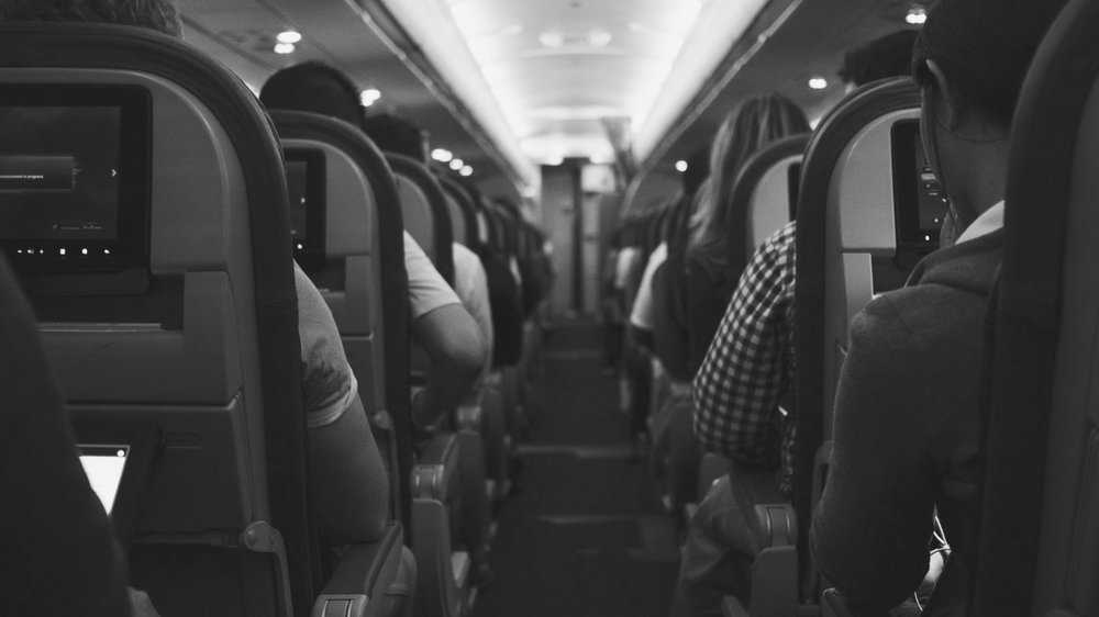 Passengers on a plane - article about using mindfulness to wake up from 'automatic pilot'