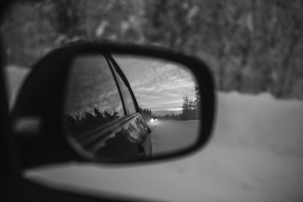 Car mirror - image accompanying an article about end of year reflections and mindfulness.