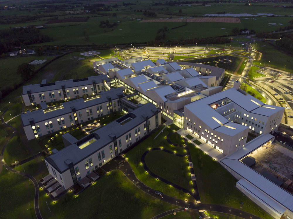 An aerial view of the new hospital from the rear just after sunset shows the garden style layout.