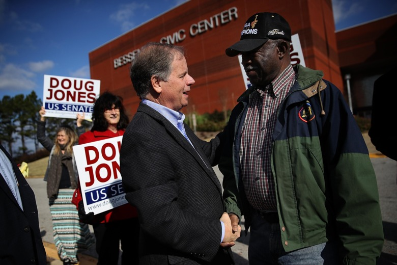 Democrat Doug Jones greets voters outside of a polling station at the Bessemer Civic Center on Tuesday in Bessemer, Alabama.  Justin Sullivan/Getty Images