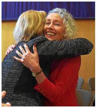 Newly elected Chester County Controller Margaret Reif gives newly elected Coroner Dr. Christina VanePol a hug, following their swearing-in ceremonies held at West Chester University Sykes ballroom Wednesday.PETE BANNAN – DIGITAL FIRST MEDIA