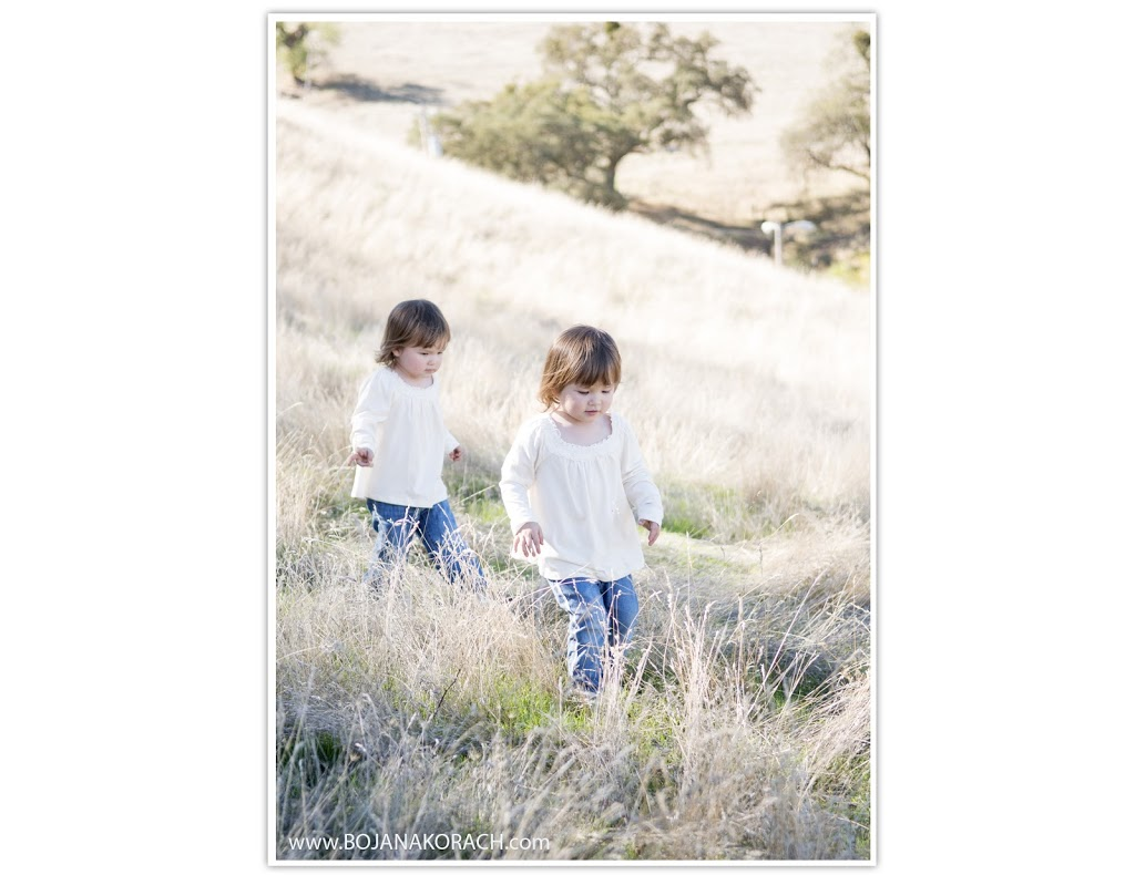 beautiful and fun twin girls walking through a field at the borges ranch in walnut creek, family photographer