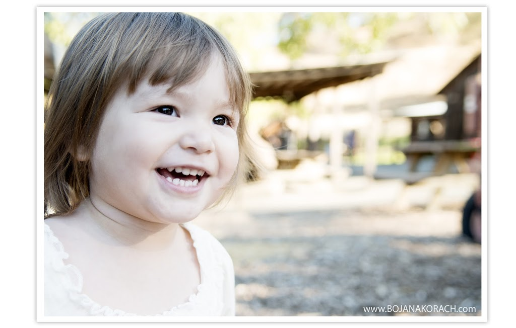 beautiful girl child smiling for a family photographer at the borges ranch in walnut creek, san francisco bay area