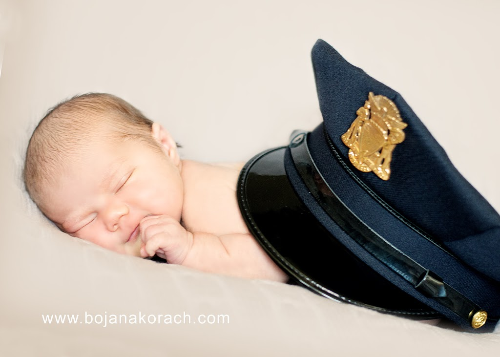 newborn baby girl with a san francisco police hat, photography