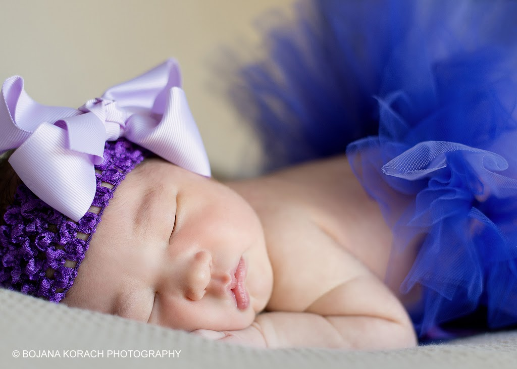 beautiful newborn baby girl wearing a purple tutu and headband in walnut creek, san francisco newborn baby photographer