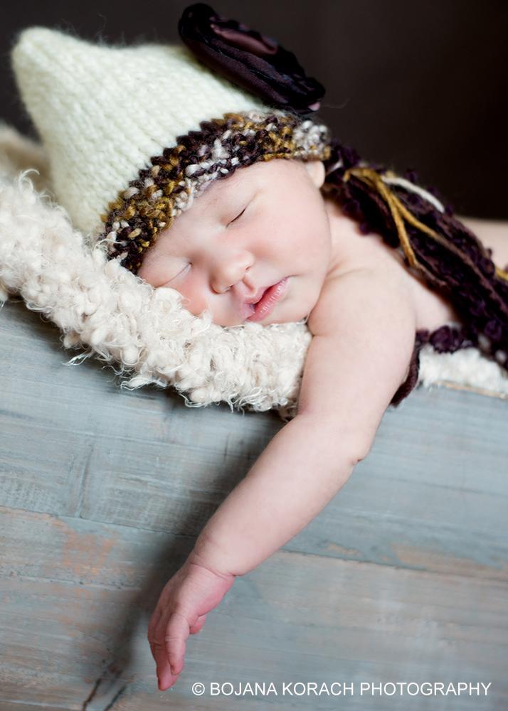 beautiful newborn baby girl sleeping and wearing a hat in walnut creek, newborn photography