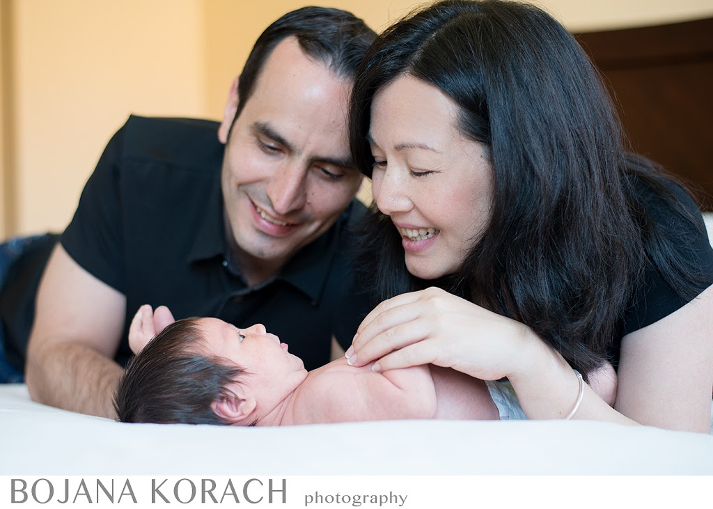 proud parents playing with a newborn baby boy in san francisco bay area, photography