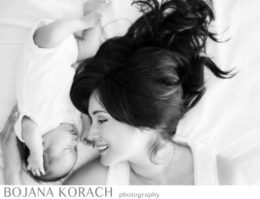 Stunningly beautiful mother with her newborn baby son in Redwood City taken by San Francisco bay area photographer