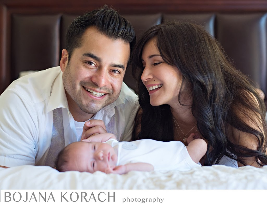 Parents smiling with their newborn son in Redwood City, San Francisco Bay Area photographer