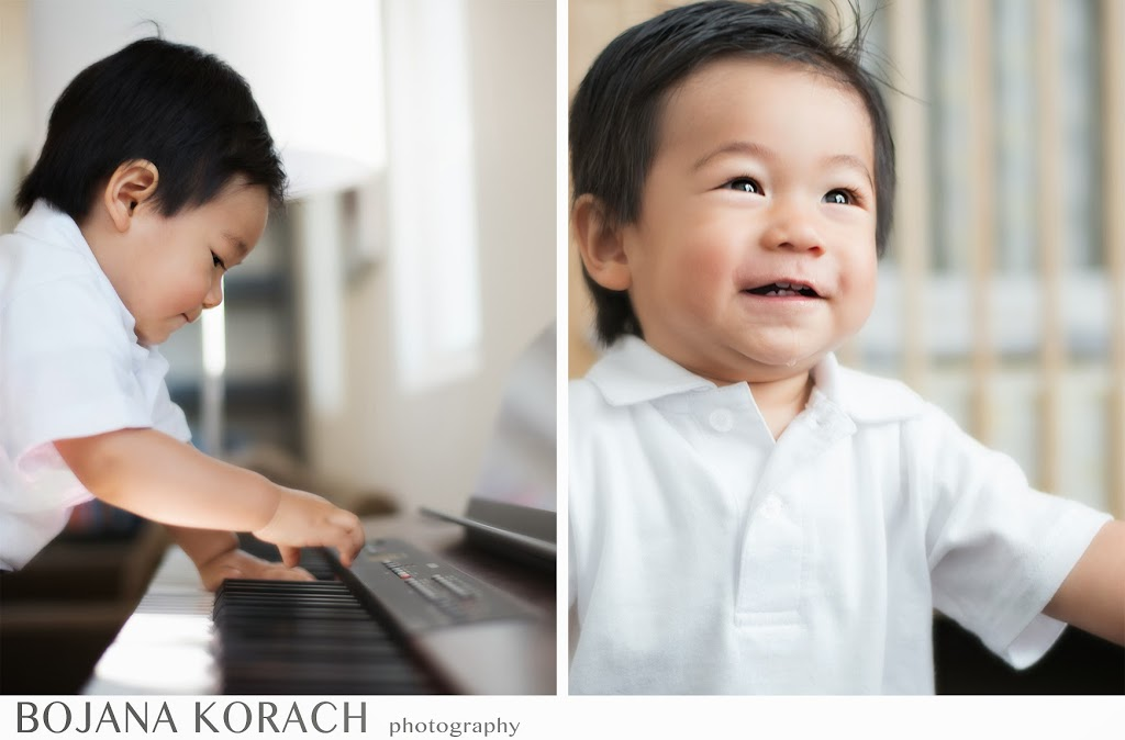 one year old playing piano at his home in danville, baby photography