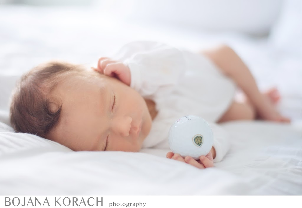 newborn baby boy holding a golf ball at his home in lafayette, newborn baby photographer