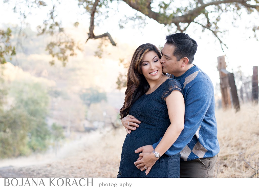 walnut creek maternity photography expectant couple happy hugging and kissing