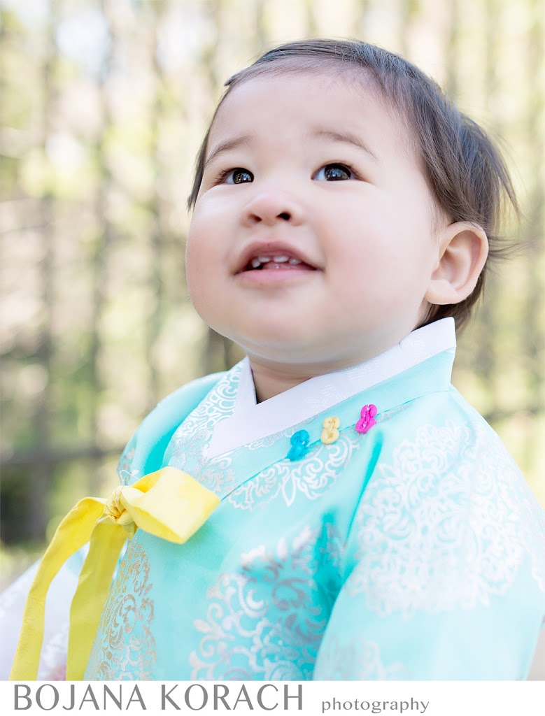 danville photographer at hap magee ranch a beautiful korean baby girl turned one years old wearing a traditional korean dress