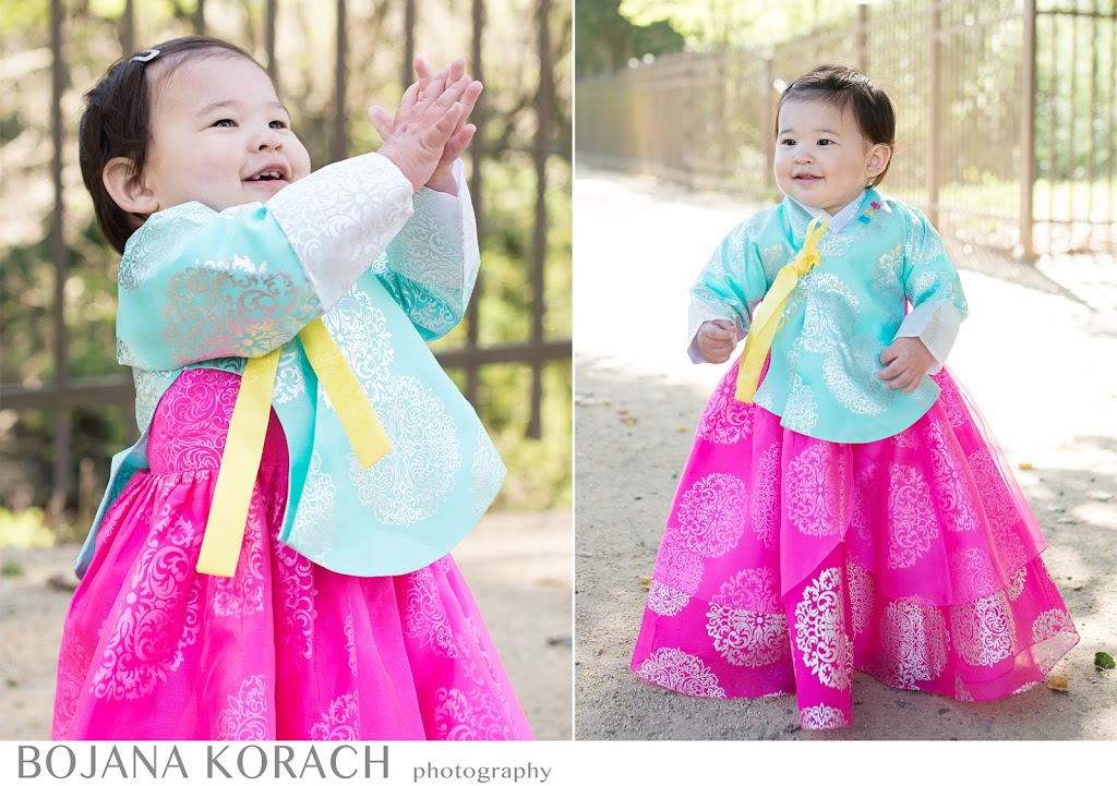danville baby photographer captures a happy baby girl dressed in a traditional korean birthday dress