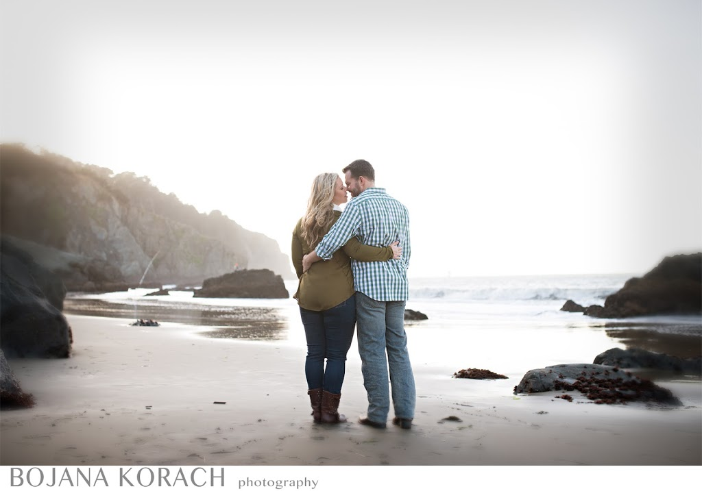 san francisco engagement and wedding photographer captures a couple kissing on china beach in san francisco as the sun is going down