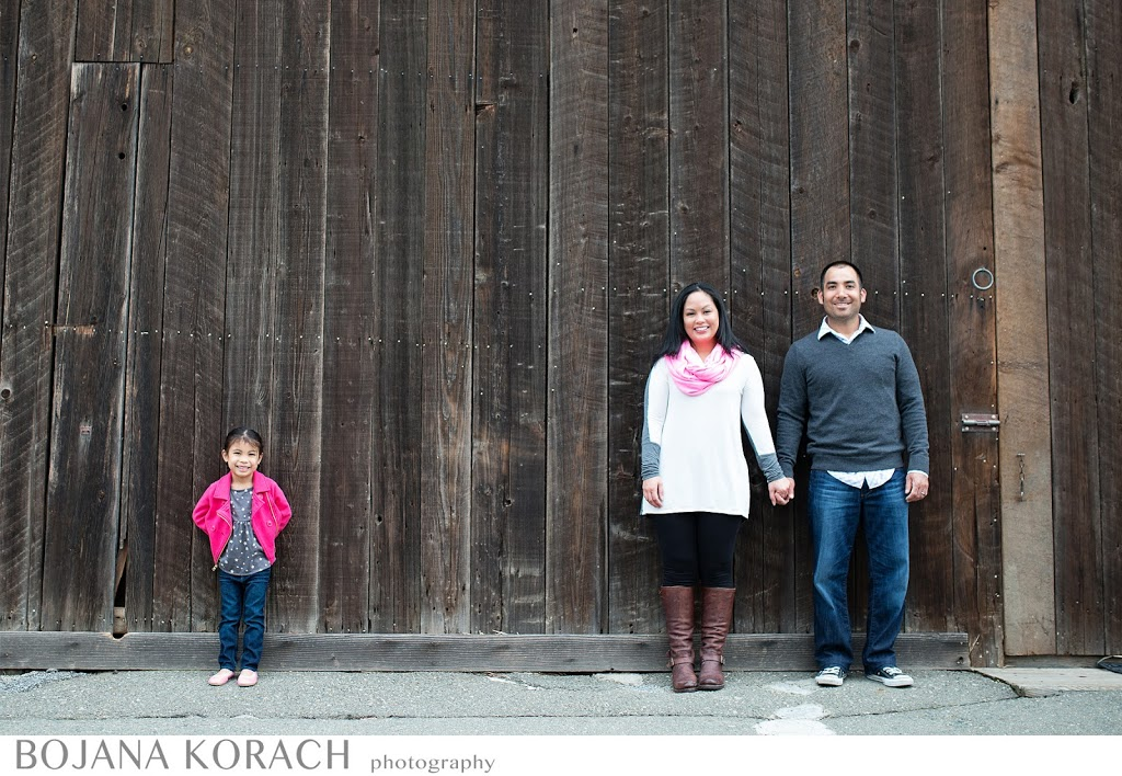 walnut creek photographer captures this wonderful family of three in a new original way, they are standing apart with the barn behind