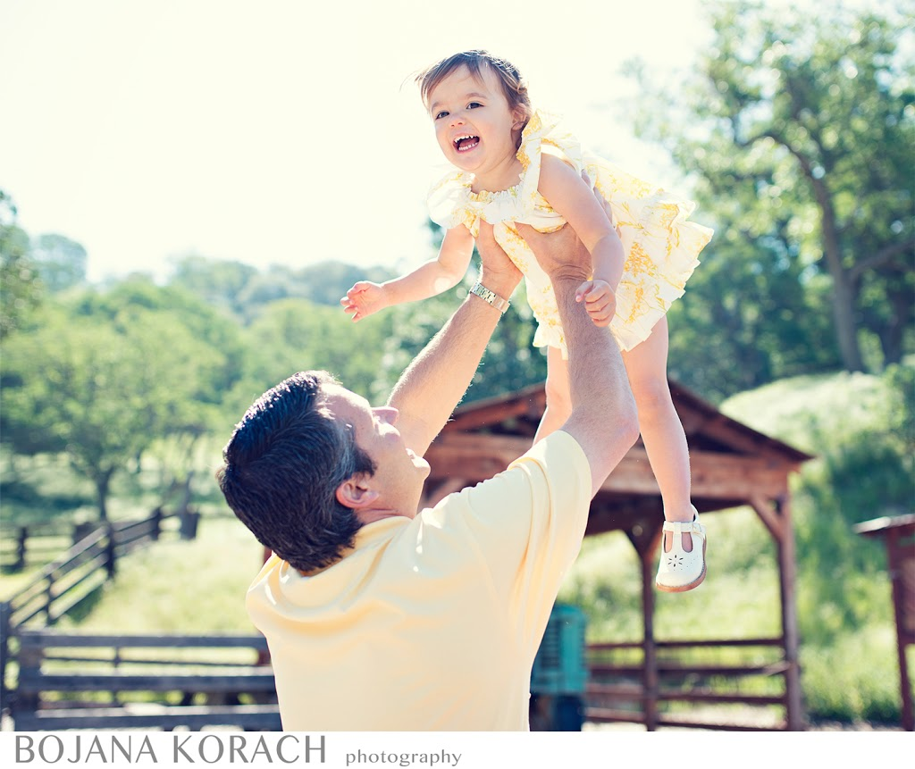 San Francisco Bay area photographer captures father holding his daughter in the air