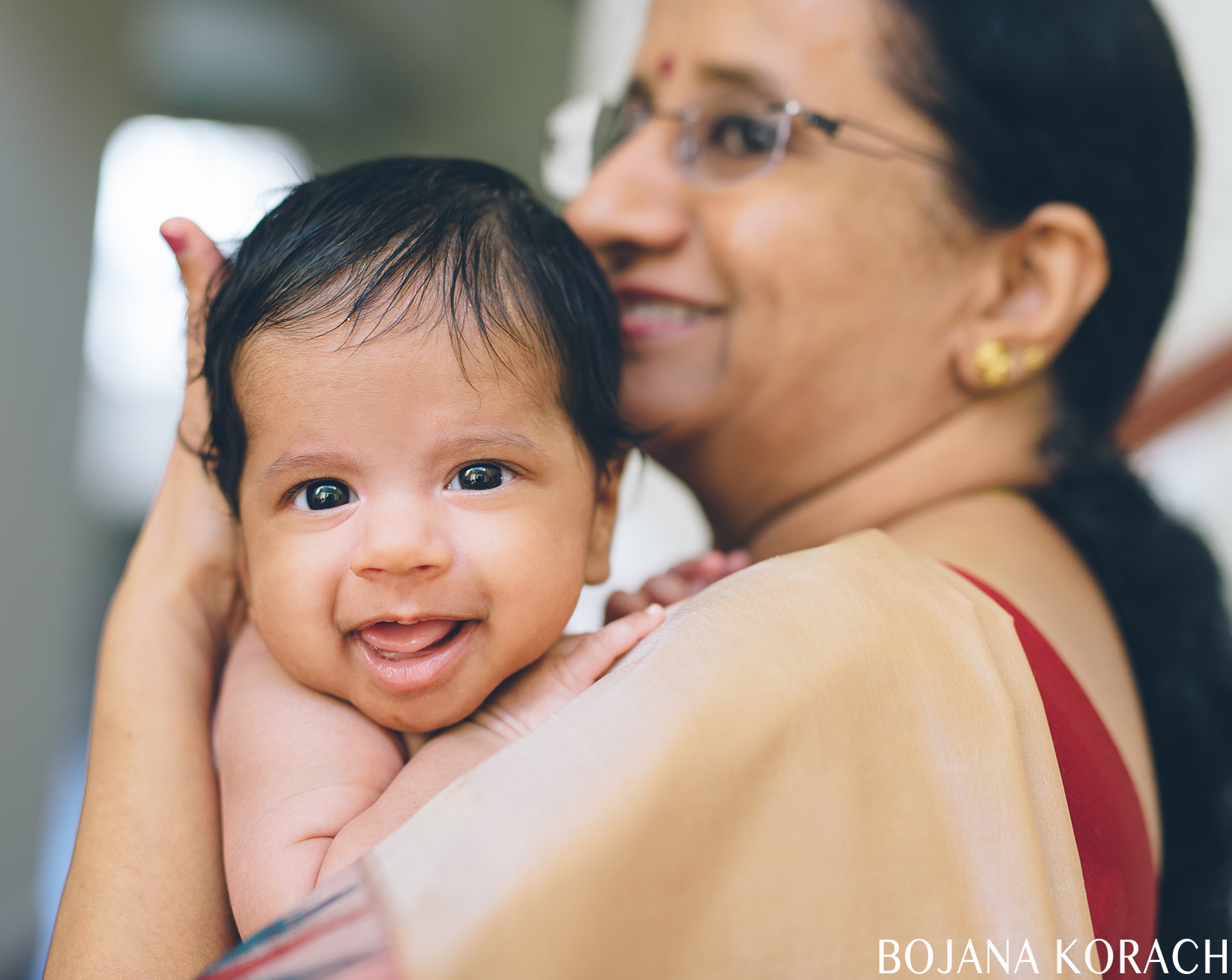 newborn baby boy photographed with his grandmother who came to visit from india
