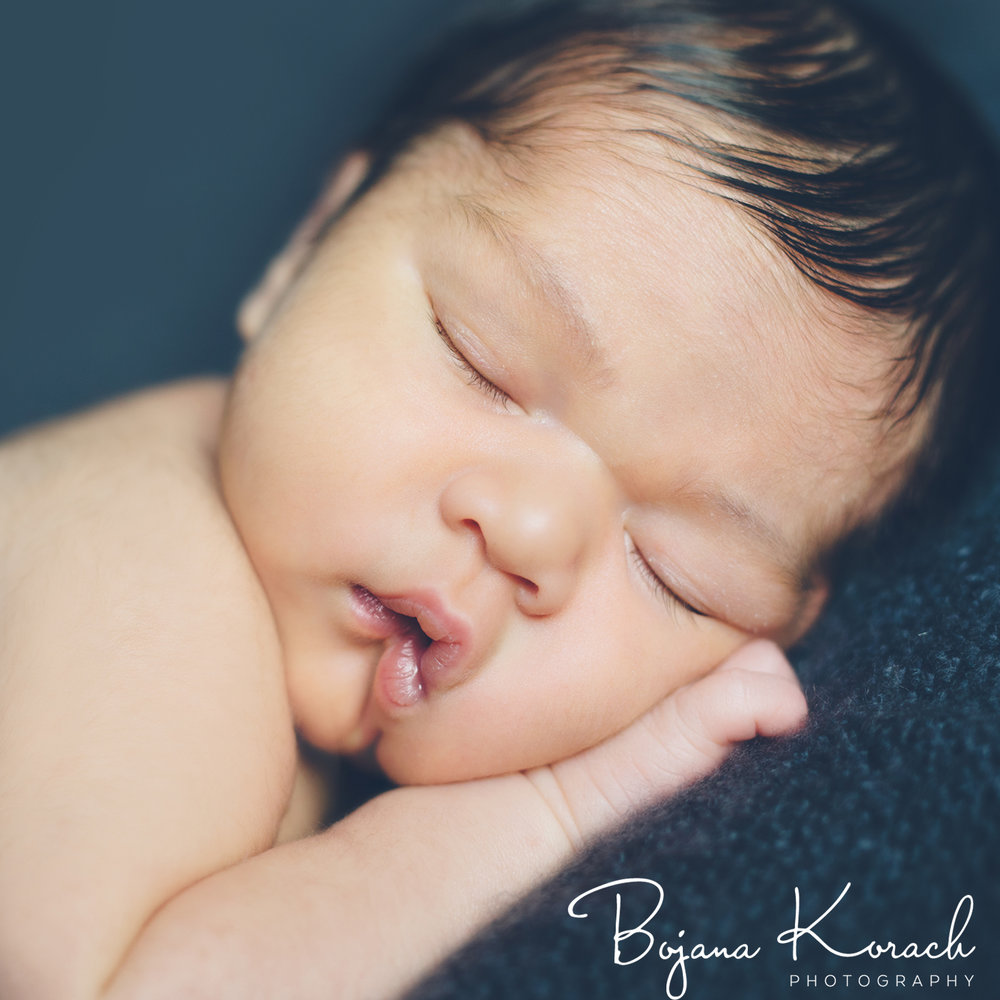 newborn baby girl sleeping photographed by chicago baby photographer