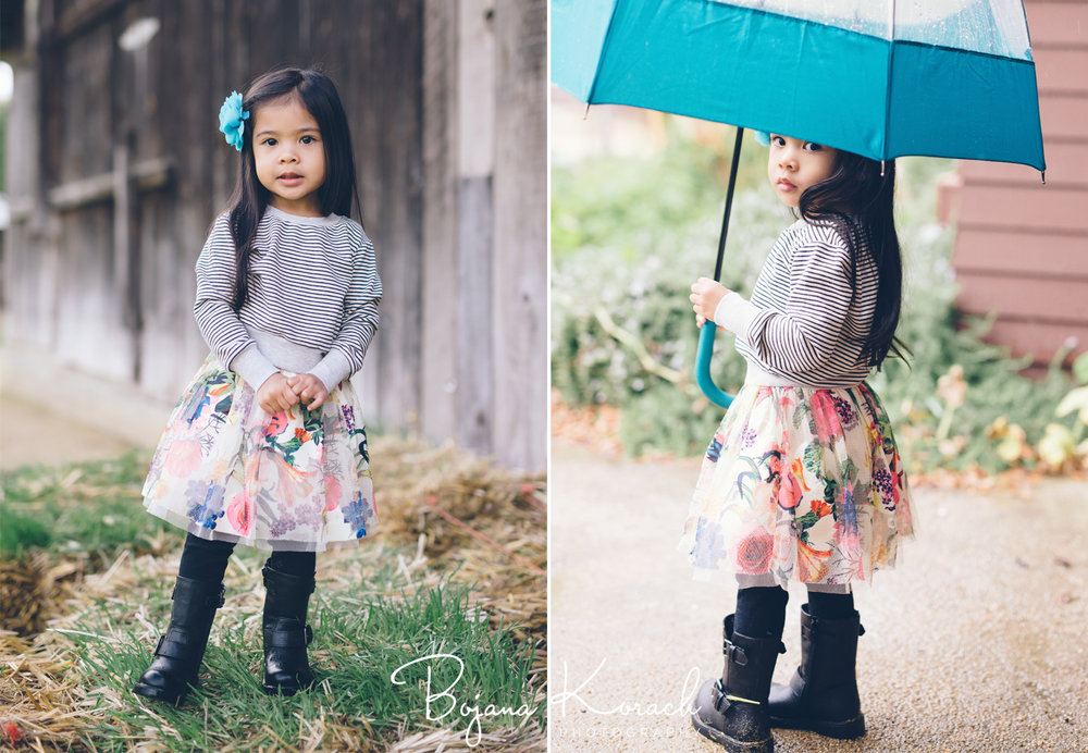 beautiful little girl with an umbrella in the rain