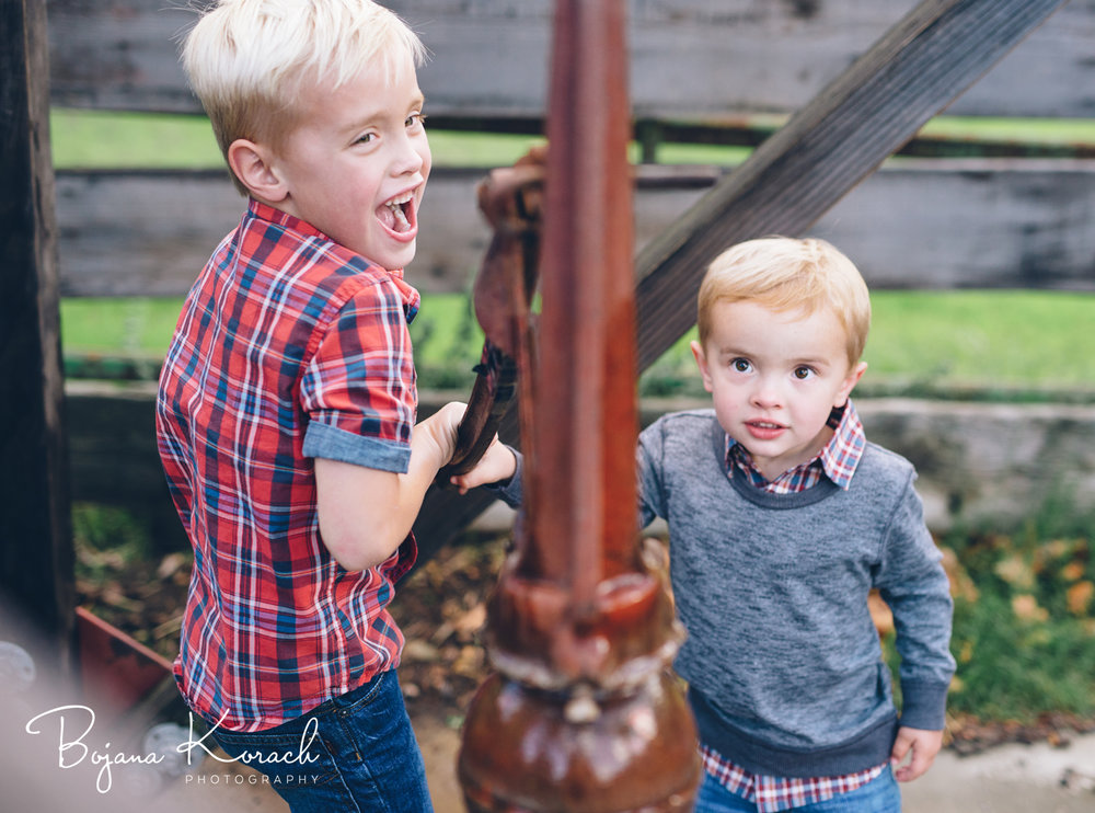 two brothers pumping water at a holiday photo session