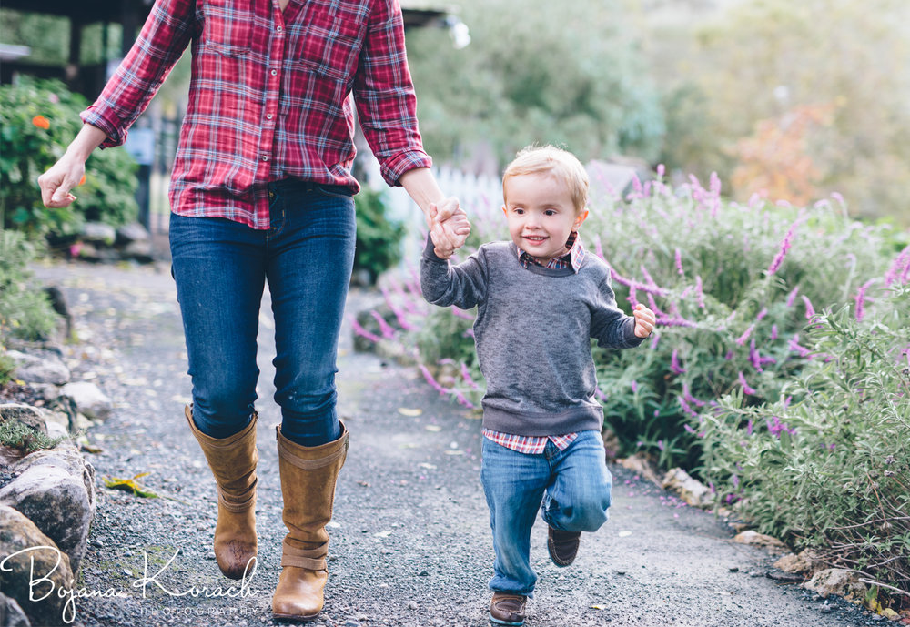mom and son running during the session at a ranch
