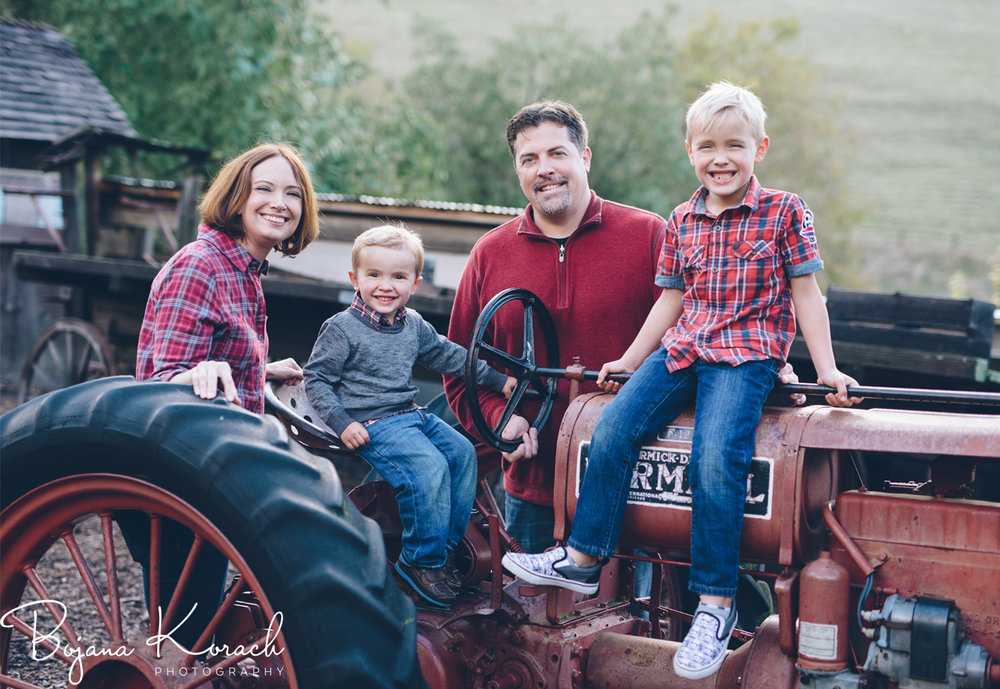 family holiday photo with a red tractor