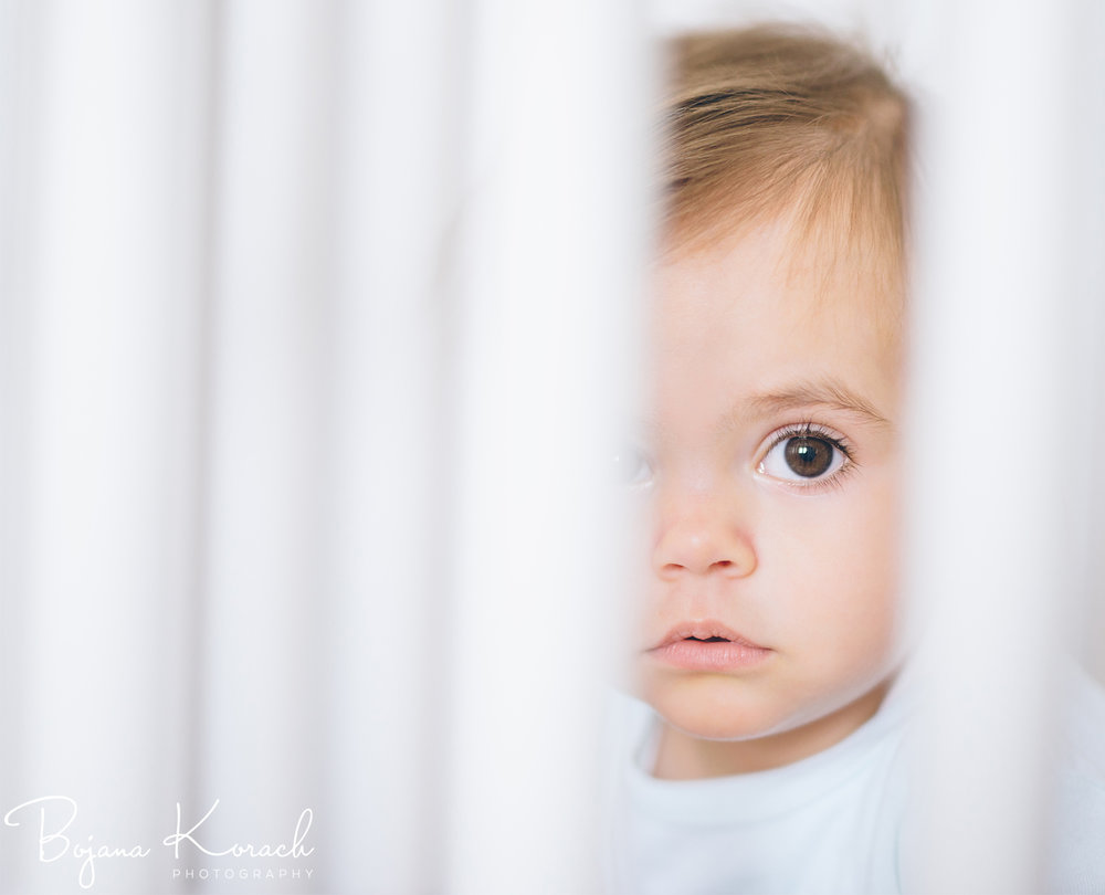 baby looking through the crib