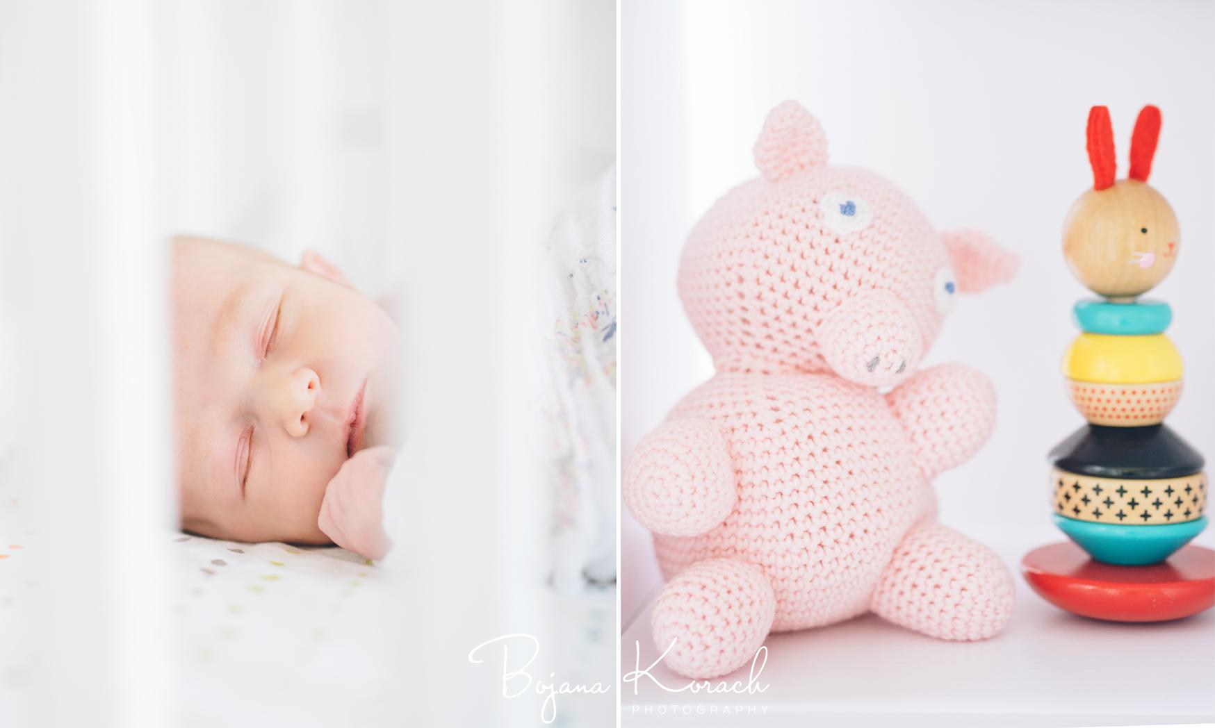 newborn baby girl sleeping in a crib