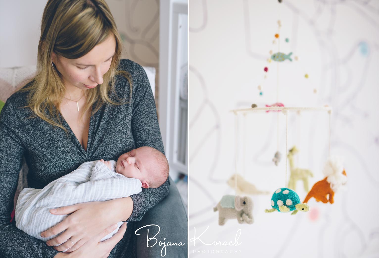 mother holding newborn girl photo
