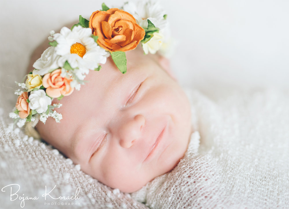 newborn girl with a beautiful hand made headband