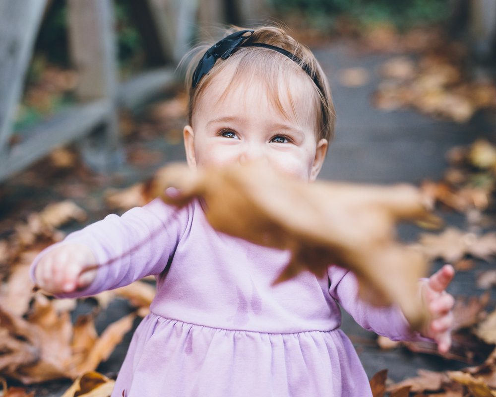 baby-having-fun-with-foliage.jpg