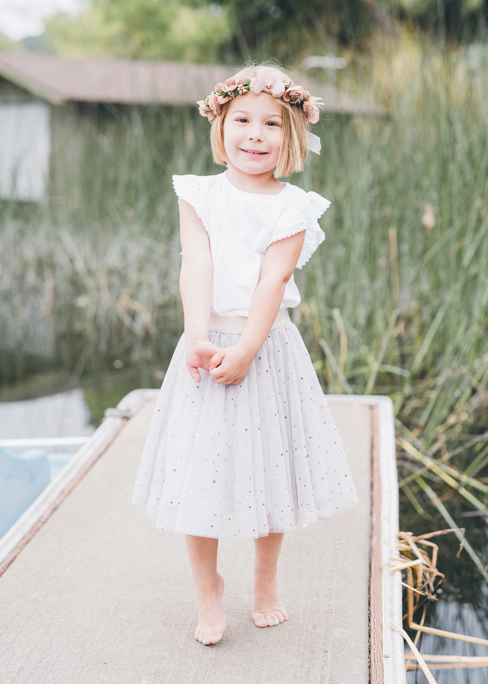 beautiful-four-year-old-girl-standing-on-the-dock.jpg