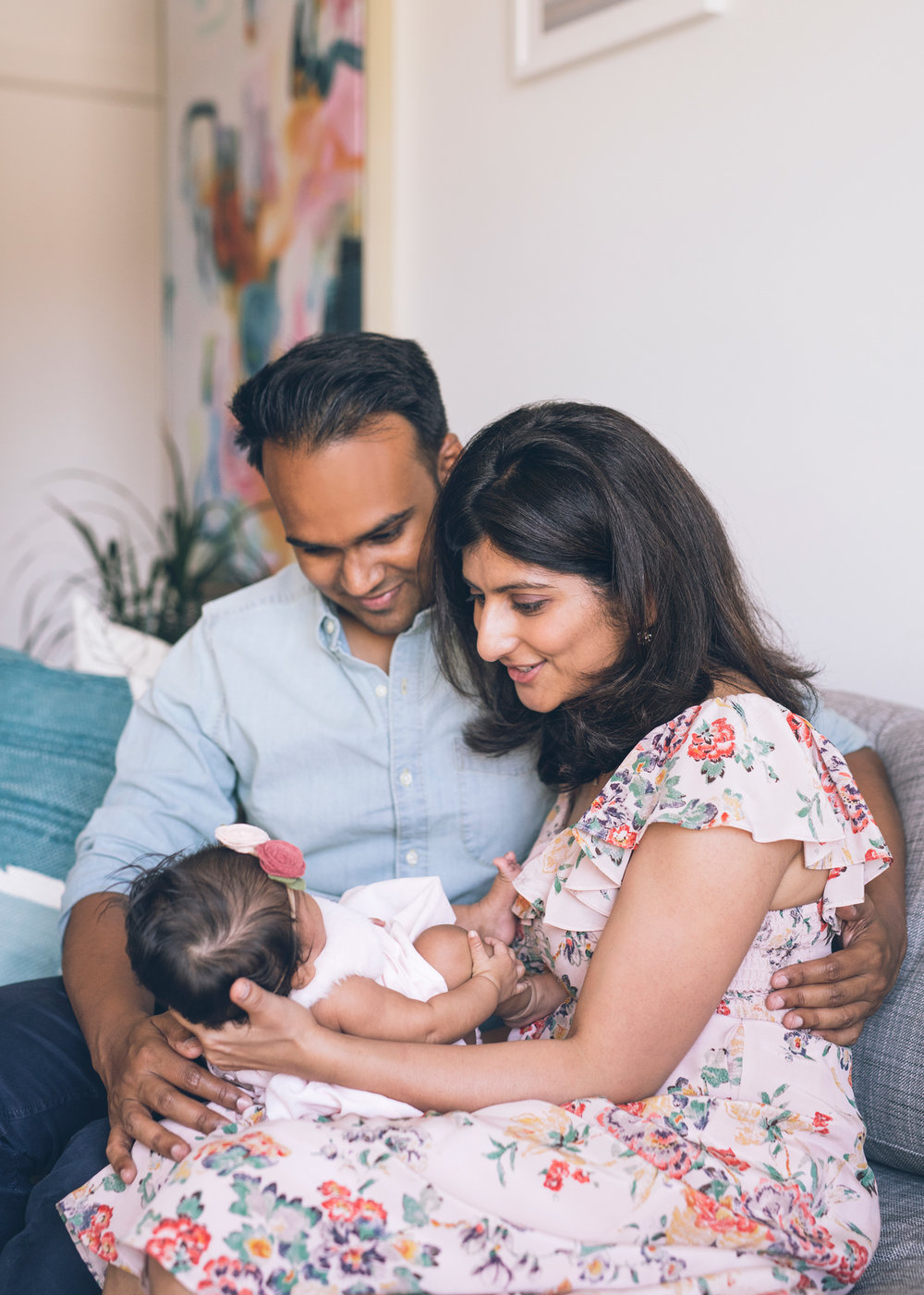parents-holding-their-baby-girl-in-their-san-francisco-apartment.jpg