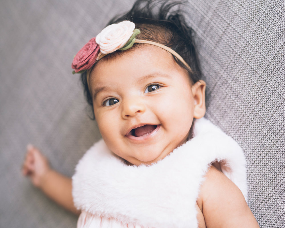 portrait-of-a-three-month-old-baby-girl-smiling.jpg