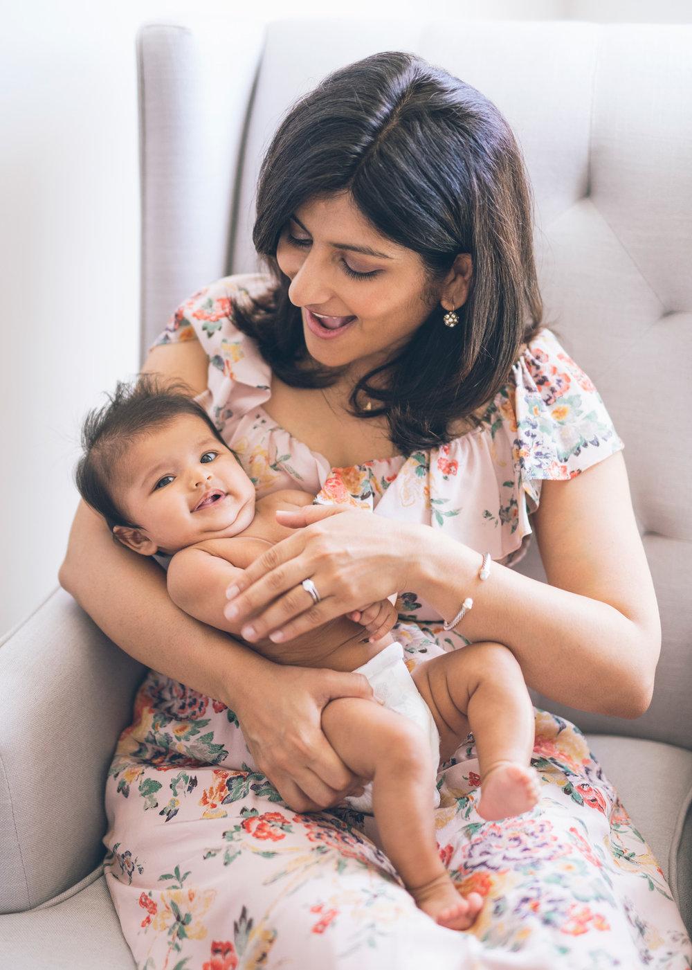 mother-holding-her-baby-girl.jpg