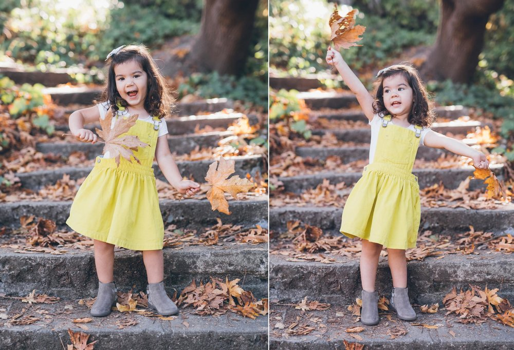 beautiful-toddler-girl-playing-with-leaves-in-the-park.jpg
