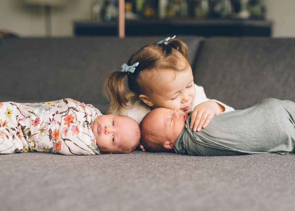 sister-hugging-her-newborn-siblings.jpg