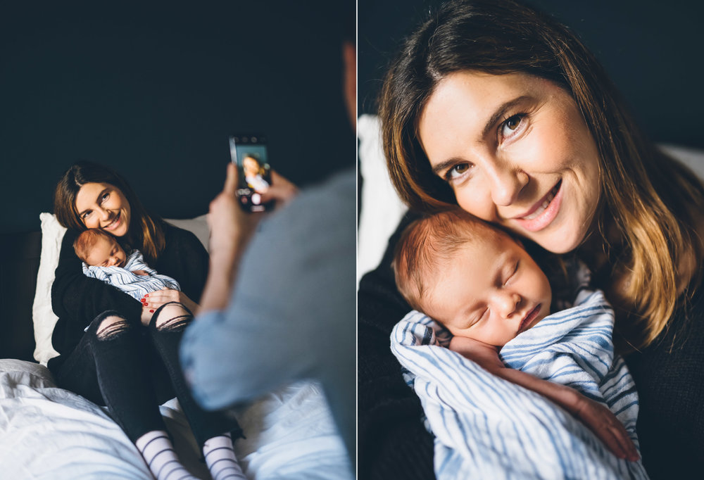 lifestyle-newborn-session-in-san-francisco-father-taking-a-photo-of-his-wife-and-baby-with-a-cell-phone.jpg