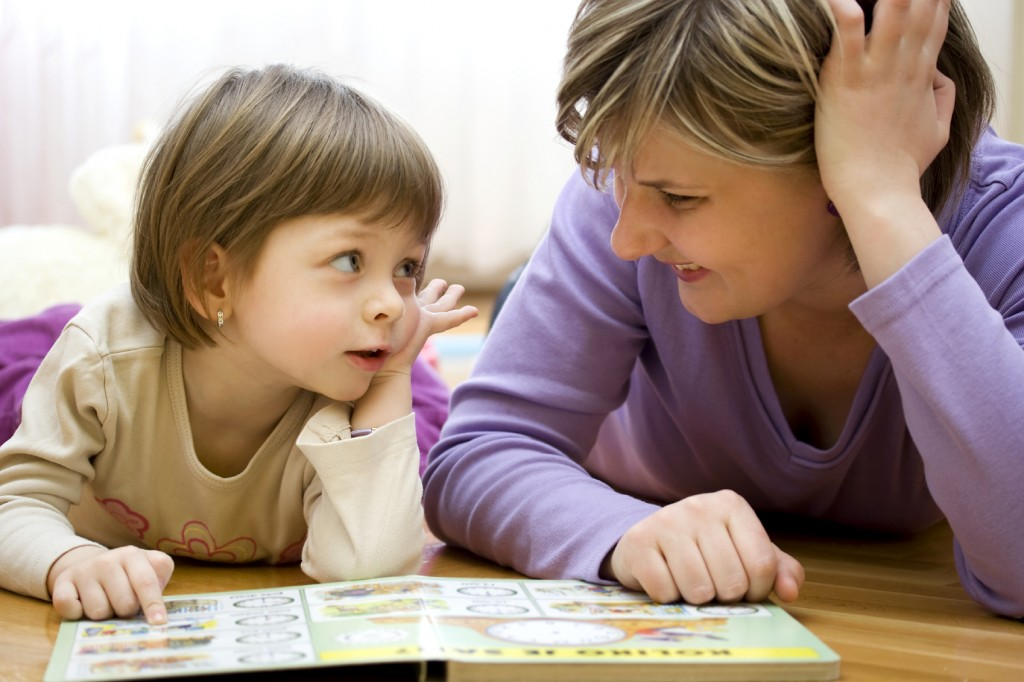 child reading book with adult_child_adult_book
