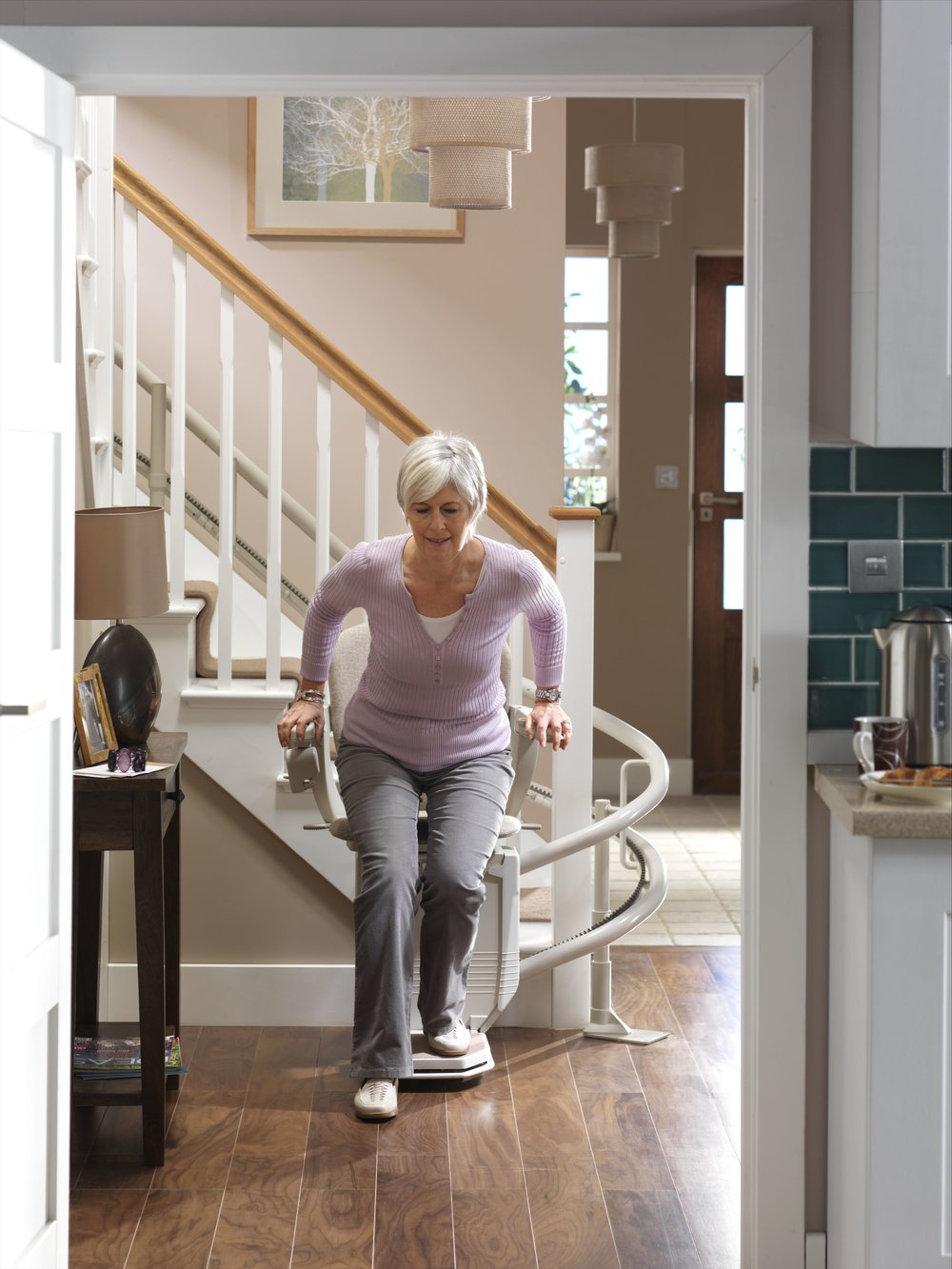 Starla-curvedstairlift-model-getting-out-square-on.jpg